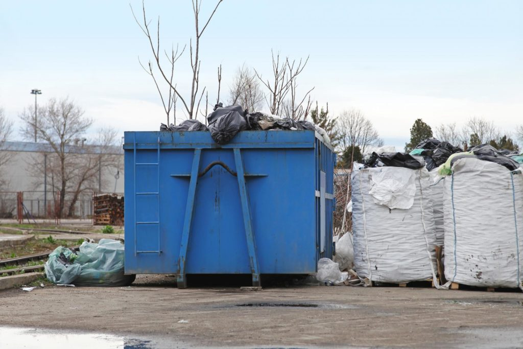 a container with overflowing trash