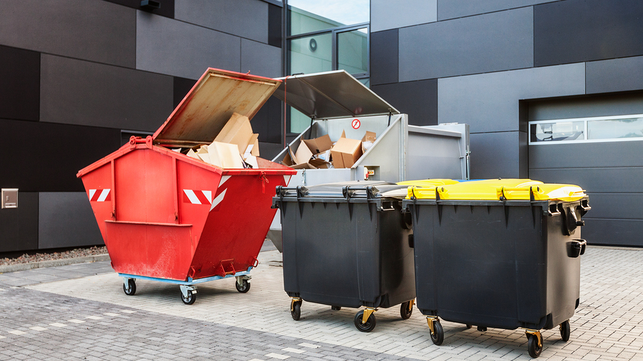 red dumpster, recycle waste and garbage bins near new office building
